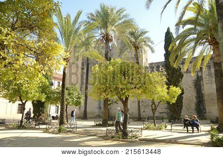CORDOBA, SPAIN - NOVEMBER 19, 2017: People at square next to the wall of the Alcazar in Cordoba Andalusia Spain.