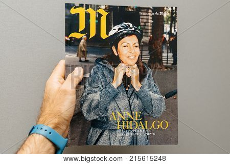PARIS FRANCE - NOV 19 2017: Man pov at the Anne Hidalgo mayor of Paris on the cover of French magazine M Le Monde