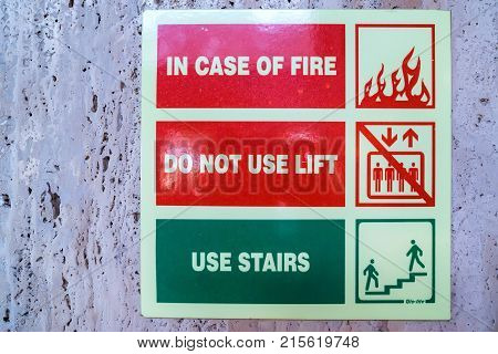 Closeup image of sign saying in case of fire do not use lift, use stairs