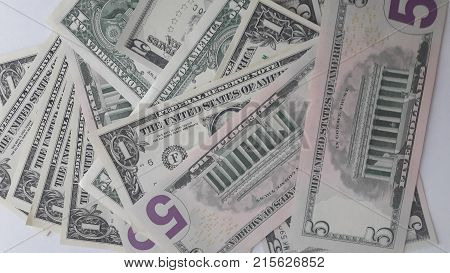 American dollar bills one and five, lie on a white background