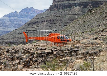 A helicopter sits on the landing pad in the Grand Canyon