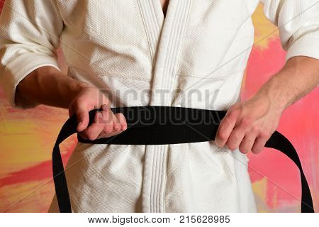 Karate Fighter With Fit Strong Hands Gets Ready To Fight.