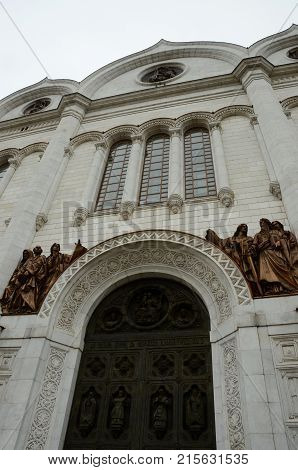 The entrance archway and bronze relief on the exterior of the Christ the Saviour Cathedral in Moscow