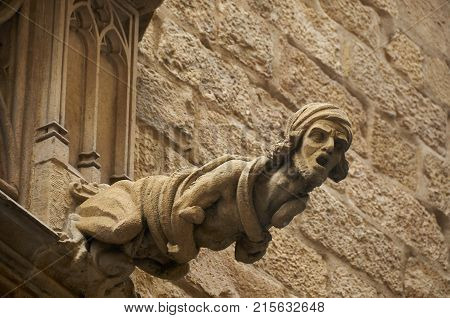 Gargoyle on a building at Carrer del Bisbe in Barri Gotic, Barcelona, Spain