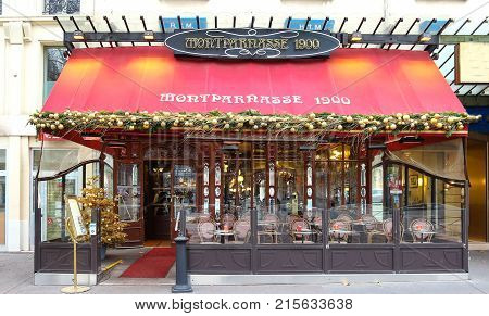 Paris, France -November 26, 2017: Typical Parisian cafe Montparnasse decorated for Christmas in the heart of Paris. Christmas is one of the main Catholic holidays, which is celebrated on a large scale throughout