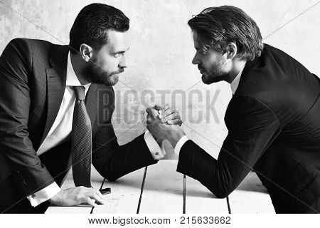 Business Rivalry In Office. Arm Wrestling Between Two Businessmans