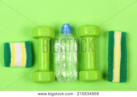 Barbells, Water Bottle Near Green Hand And Head Bands