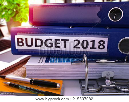 Blue Office Folder with Inscription Budget 2018 on Office Desktop with Office Supplies and Modern Laptop. Budget 2018 Business Concept on Blurred Background. Budget 2018 - Toned Image. 3D Render.