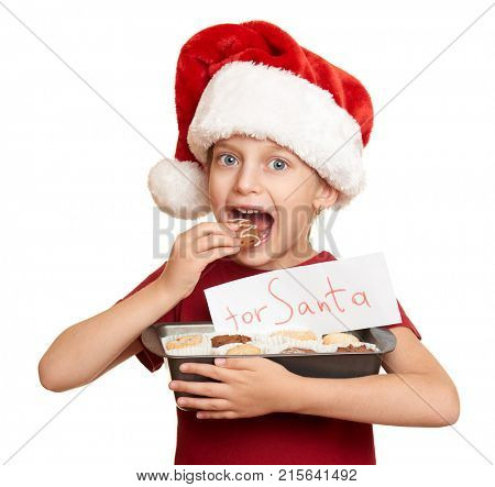 Child dressed in santa hat with cookies isolated on white background. New year eve and winter holiday concept.