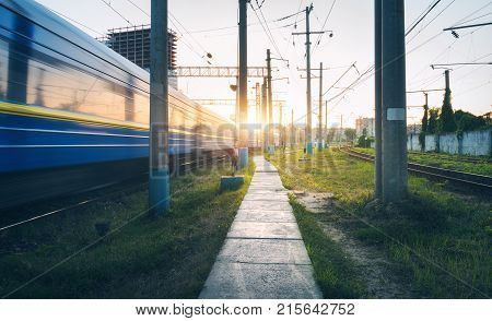 Passenger Train In Motion On Railroad Track. Blurred Train