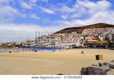 Los Cristianos beach Tenerife Canary Islands Spain Europe - June 13 2016: Hotels and apartments in Los Crristianos