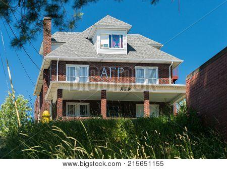 MORGANTOWN, WEST VIRGINIA - JUNE 12, 2016: Alpha Gamma Rho Greek Letter Organization housing with Confederate Flag at West Virginia University in Morgantown