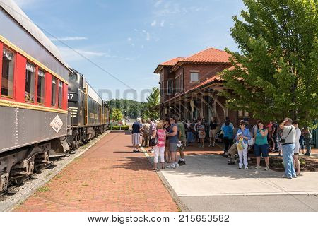 ELKINS, WEST VIRGINIA - JUNE 19, 2016: Tourists ready to board Tygart Flyer ready for trip into mountains of West Virginia by Durbin and Greenbrier Vallery Railroad