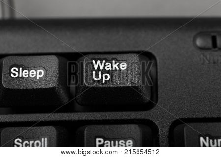 button wake up and sleep on the keyboard conceptual photo close-up