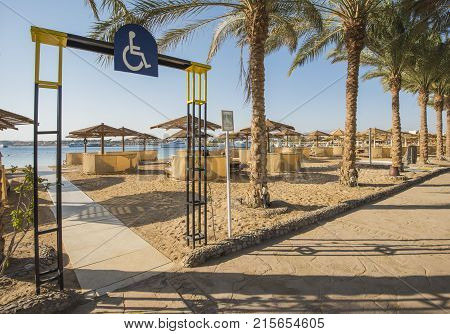 Tropical Sandy Beach With Disabled Access At A Hotel Resort
