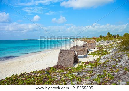 Cayo largo beach Cuba with huts in a sunny day