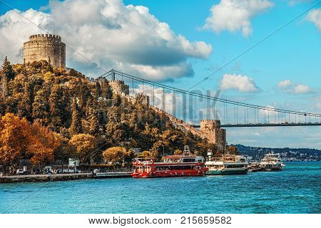 ISTANBUL TURKEY: Rumeli Hisari fortress and the Fatih Sultan Mehmet Bridge on the Bosphorus on the Bosphorus in autumn on October 3 2017