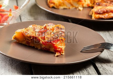 Tortilla De Patatas. Spanish Omelette With Sausage Chorizo, Potatoes, Paprika And Egg, Accompanied B