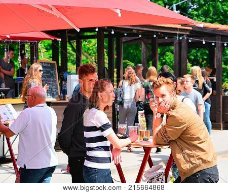 Vilnius Lithuania - June 9 2017: People drinking beer at Open Kitchen food festival in Vilnius Lithuania.