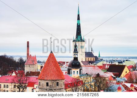 Cityscape with St Olaf Church and defensive walls at the Old town of Tallinn Estonia in winter. View from Toompea hill