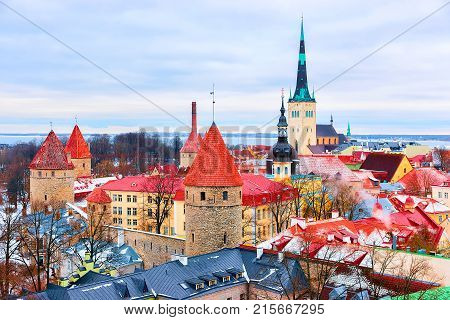 Cityscape with St Olaf Church and defensive towers at the Old town of Tallinn Estonia in winter. View from Toompea hill