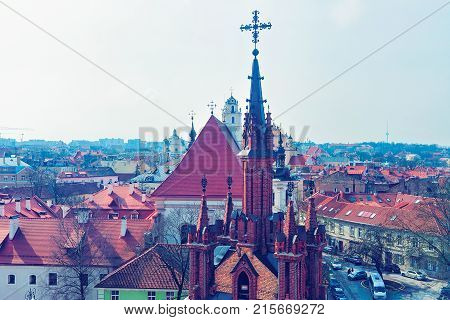 Steeples of Church of St Anne and cityscape in the Old city Vilnius Lithuania.