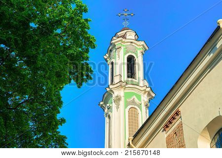 Steeple of the Church and monastery of Holy Trinity in the Old city of Vilnius Lithuania