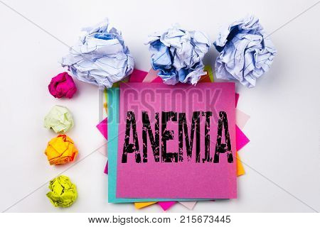 Writing Text Showing Anemia Written On Sticky Note In Office With Screw Paper Balls. Business Concep