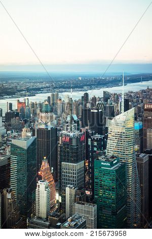 New York USA - April 25 2015: Aerial view from Observatory deck in the Empire State Building on Midtown district of Manhattan in New York NYC. Hudson river is on the background.
