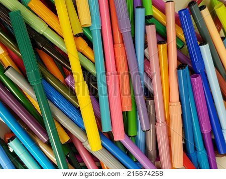 drawing or stacking markers stacked, untidy of various colors, background