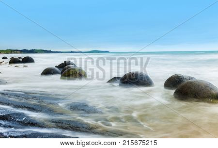 Spheric Moeraki Boulders on the Koekohe beach, Eastern coast of New Zealand.