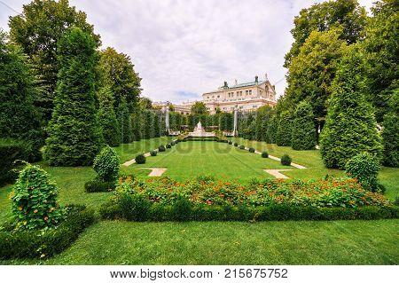 Vienna Austria - August 21 2012: Volksgarten public park or People Garden with Empress Elizabeth Monument of Hofburg Palace Vienna in Austria.