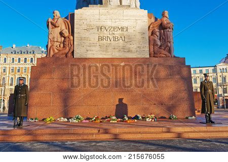 Riga Latvia - December 25 2011: Freedom monument with honour guards in Riga Latvia