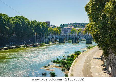 Ponte Sant Angelo Bridge over Tiber River Rome Italy. The bridge is also called as the Bridge of Hadrian or the Aelian Bridge; or Pons Aelius.