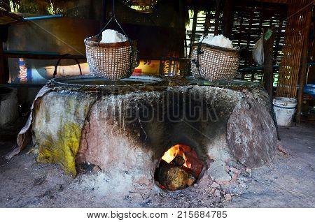 Thai People Use Ancient Old Stove For Make Rock Salt At Ban Bo Kluea Village In Nan, Thailand
