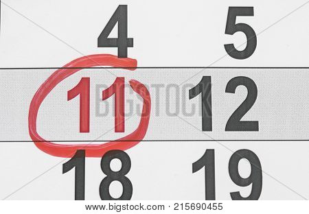 eleventh day of the month is marked with a red mark.