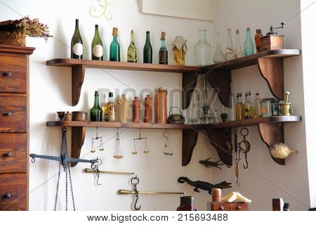 Old Pharmacy Interior With A Bottles Medicine And Old Equipment