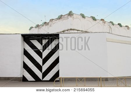 Black and white stripes on a metal gate