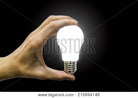 hand holding glowing polygonal lamp on background black. Innovative ideas concept. Bright idea. the way to solve problem Good solution.. business finance.