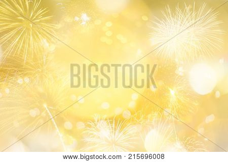 Gold glitter Christmas abstract background with light bokeh and fireworks for Xmas season decoration or new year party celebration