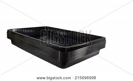Capacities for capillary watering of indoor plants. Black plastic pockets, which are filled with capillary mats that absorb and retain water. Isolated on white background