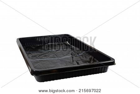 Assembling the device to facilitate the care of indoor plants. Over the capillary mat from white synthetic felt, which holds water, lying in a black plastic pallet, is laid a fine-pored black protective film. Isolated on white background
