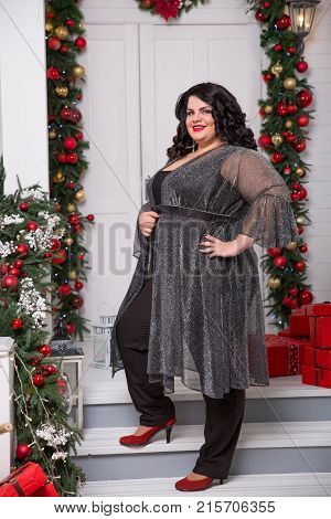 portrait of beautiful brunette plus size young woman. New year or Christmas background