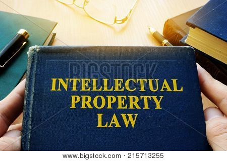 Copyright infringement concept. Intellectual property law and other documents on a desk.
