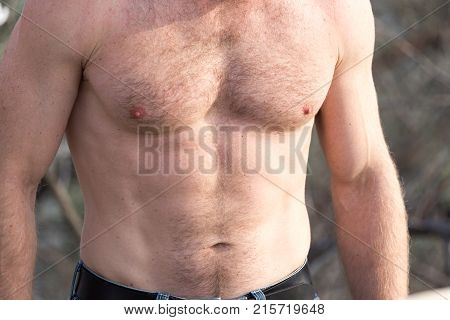 men inflated chest as background . In the park in nature