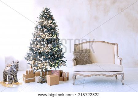 Large White Living Room With A Vintage Sofa And A Large Christmas Tree