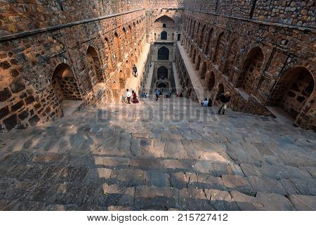 NEW DELHI, INDIA - CIRCA NOVEMBER 2017: Underground step-well Ugrasen ki Baoli in heart of New Delhi, India. 14th Century AD. It is a protected monument and built by Maharaja Agrasen in the Mahabharat era.