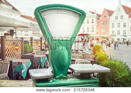 Old scales in the street on the square of the old city of Tallinn in the afternoon, Estonia