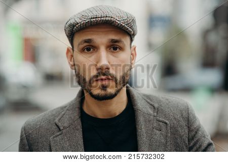 Man Gangster In A Cap And Beard Close-up