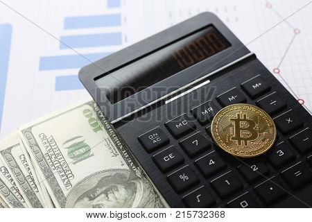 The bitcoin lies on keyboard of black calculator against background USD graph financial statistics large. Subjects growth depreciation rate rypto currency up to 10000 items of exchange transactions